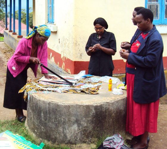 Women-using-the-paper-cutter-they-bought-with-a-loan-to-make-paper-beads